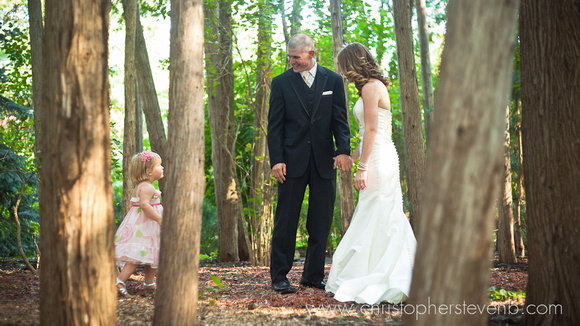 flower girl makes bride and groom laugh