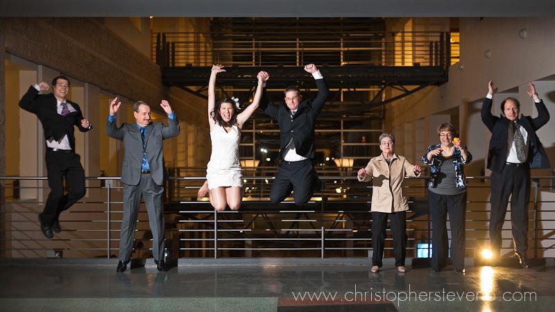 Wedding party jumping outside of Ottawa city Hall wedding chamber