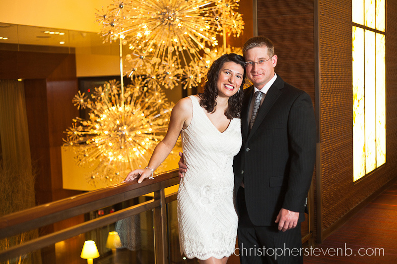 bride and groom posing on mezzanine of Ottawa Westin
