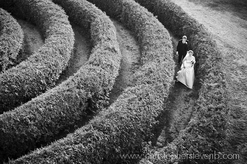 bride and groom in Saunders Farm Hedge maze