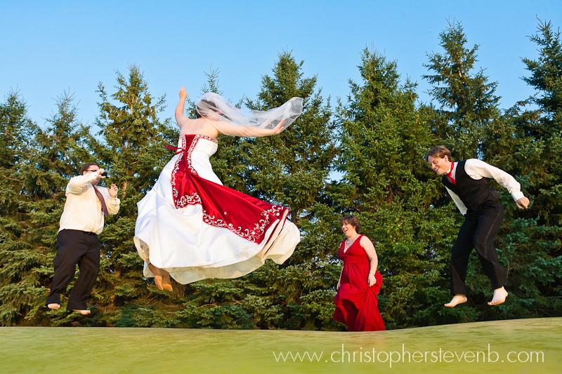 wedding party having fun jumping on trampoline