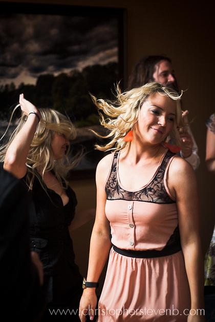 guests dancing wildly at Greyhawk Golf Course wedding reception