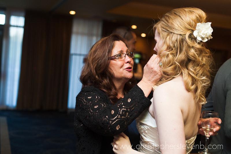 wedding guest embracing bride at reception