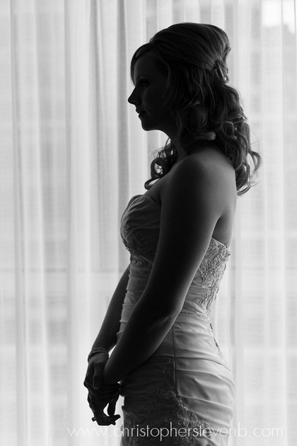 silhouette of bride in front of window