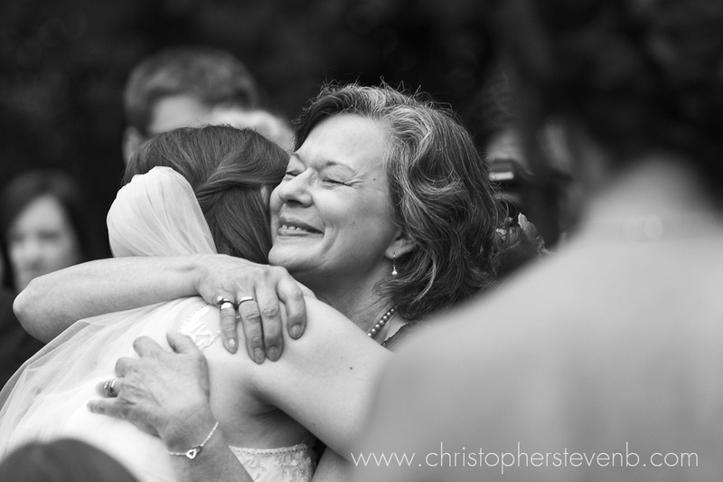 emotional photo of bride's mother hugging bride