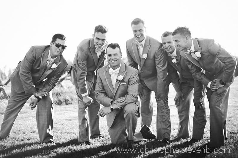 groom and groomsmen huddle after Ottawa wedding