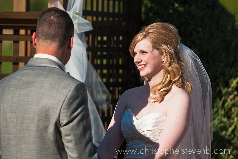 bride and groom doing vows at wedding ceremony