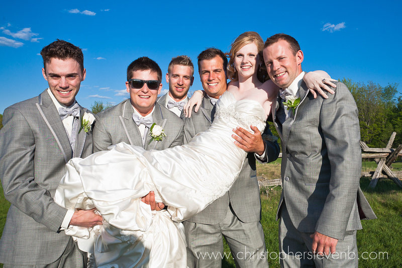 groomsmen lifting the bride