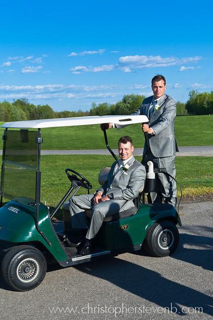 groom and best man sitting on golf cart at Greyhawk