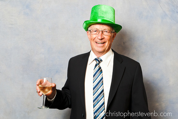 older man with irish green top hat in photo booth