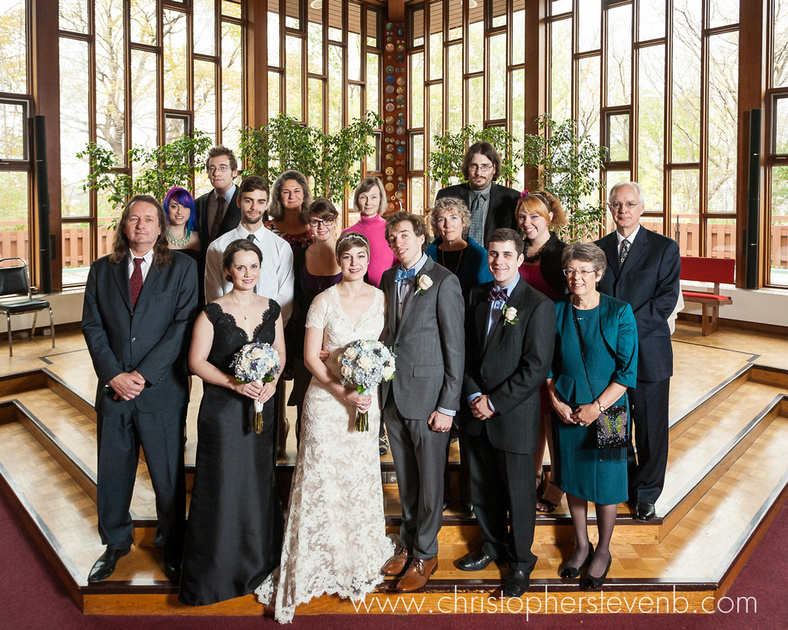 Group photo at Ottawa wedding in church with modern windows in background