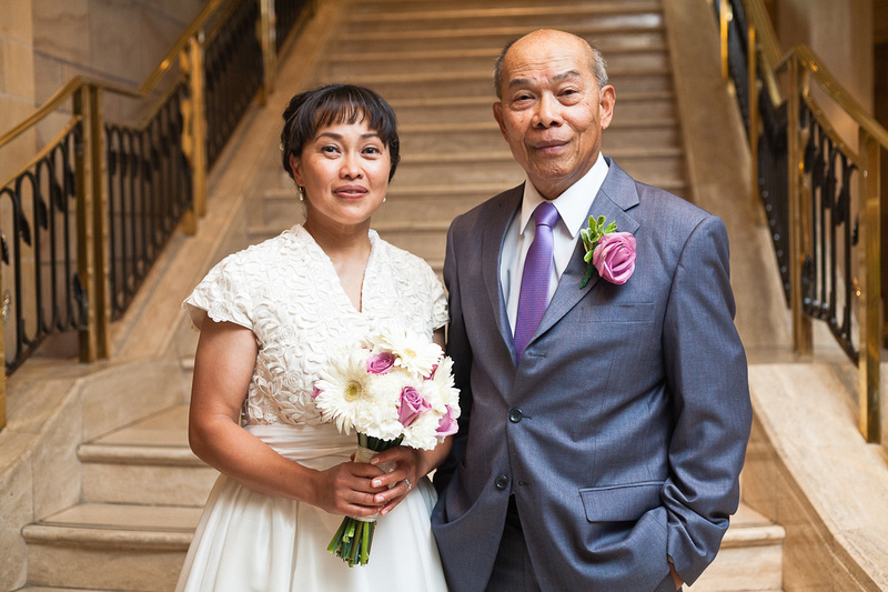 bride and her father at foot of stairs