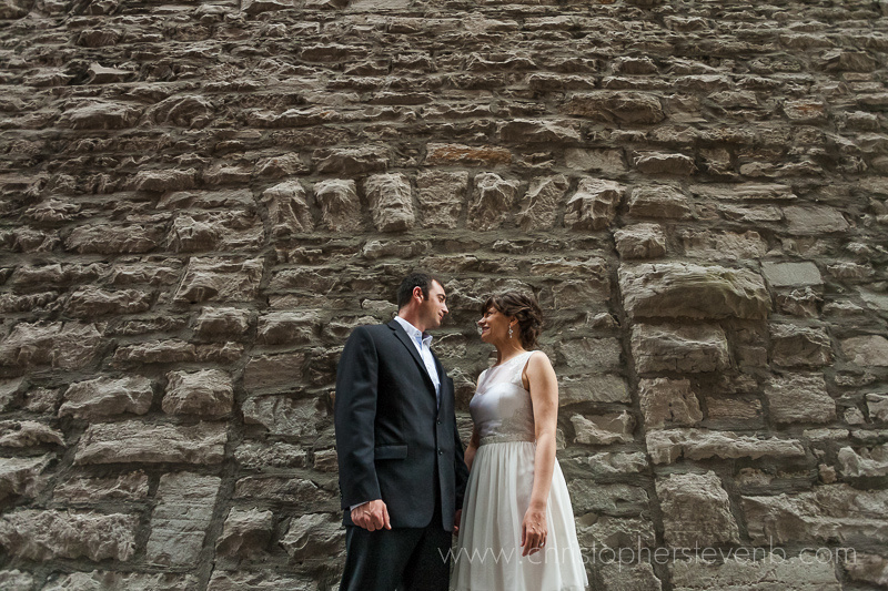 wedding couple in front of Rock wall in byward market