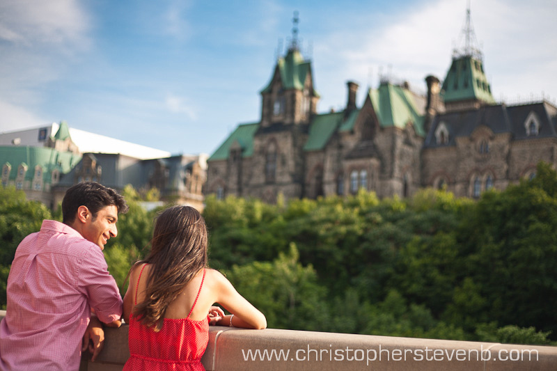 man smiling at fiance with parliament in the background