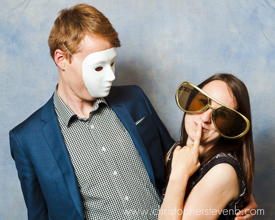 couple posing with mask and big sunglasses