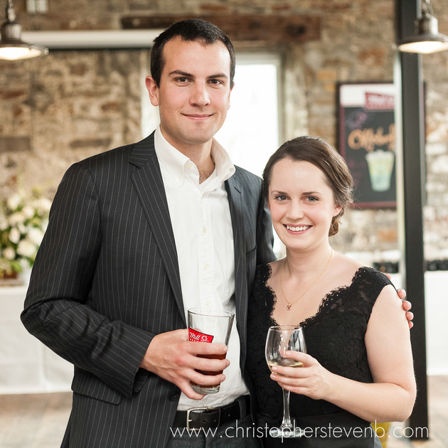 Mill Street Pub wedding couple with glass of wine and beer
