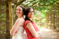 Bride and bridesmaid back to back