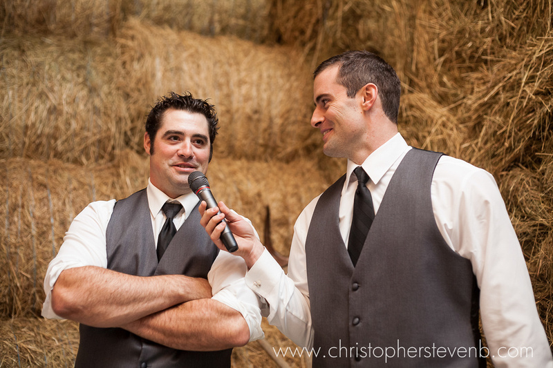 brothers of the groom giving speech during farm wedding reception