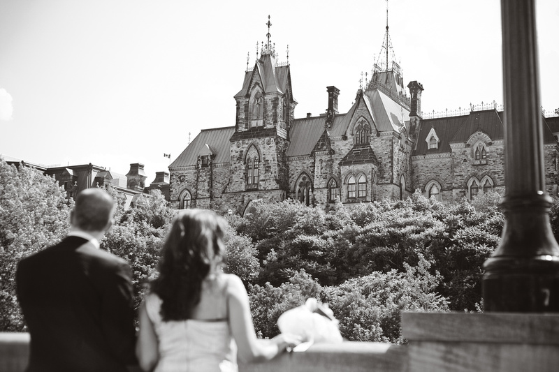 Civic wedding couple looking at Parliament in Ottawa