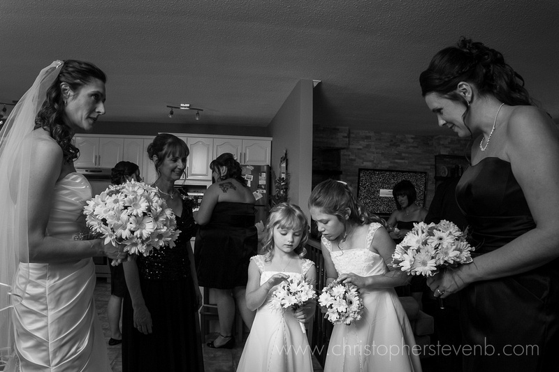 flower girls talking in the middle of a busy wedding morning