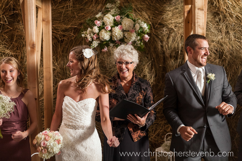 wedding ceremony in rustic barn in Hawkesbury, Ontario