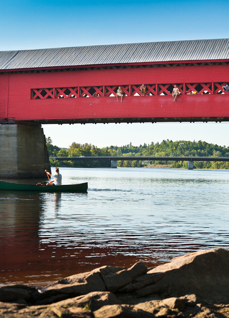 Wakefield covered bridge with swimming rocks and canoe