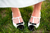 Bride's black and white shoes at wedding