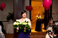 bridesmaid carrying flowers during processional