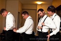 "groom and groomsmen putting on suspenders via ""suspender train"""