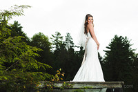 full length photo of beautiful bride in Wakefield with trees