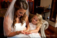 flower girl shows painted fingernails to bride