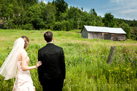 wedding couple looking at barn in wakefield