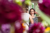 bride getting ready photographed through bouquet