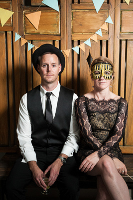 Photo booth image of wedding guests with masquerade mask