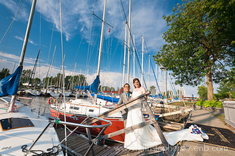 bride and groom portrait amongst boats at Britannia Yacht Club harbour