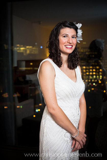 Bride in front of window showing downtown Ottawa