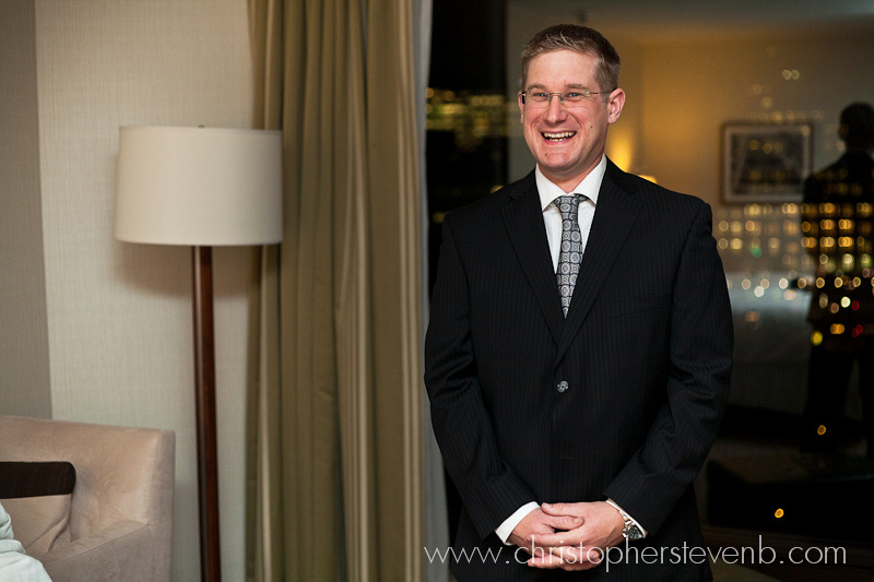 Groom smiling and awaiting bride