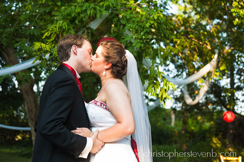 bride and groom kiss at Saunders Farm wedding
