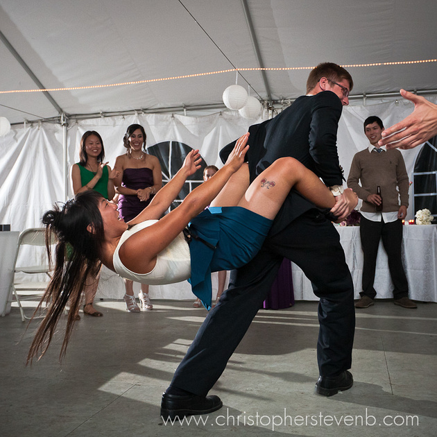 funny wedding photo of guest falling while dancing