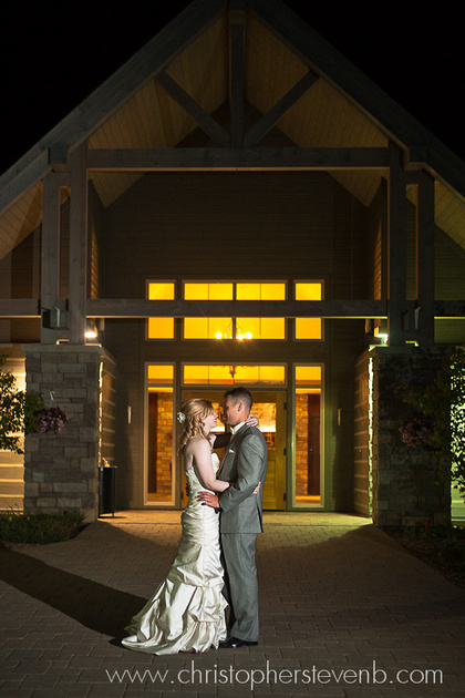 last photo of the night, with the bride and groom standing in front of the Greyhawk Golf Club