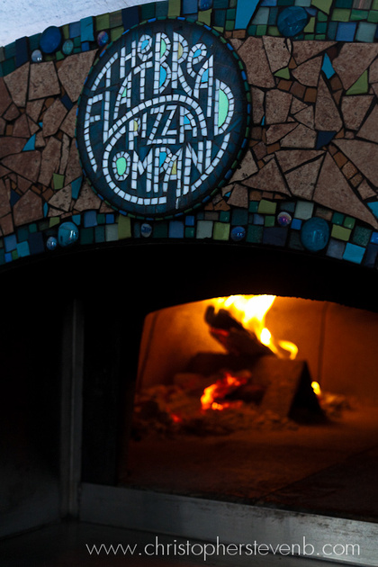 Flatbread Pizza Company oven with pizza cooking