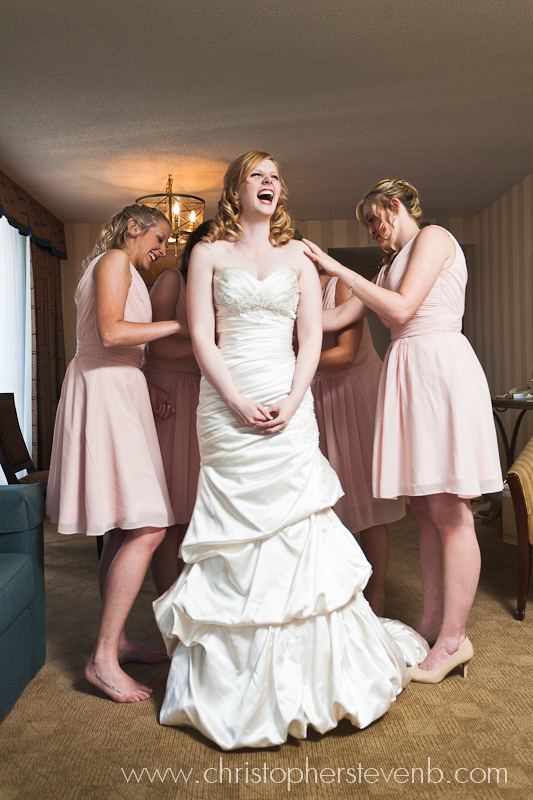 Bride laughing with bridesmaids at Ottawa wedding