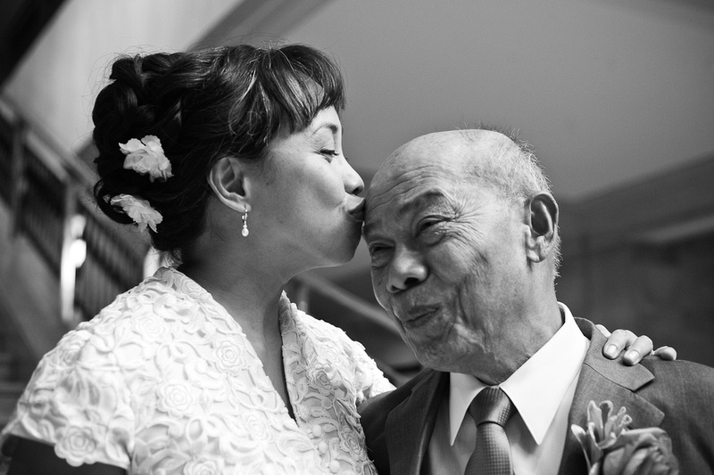 bride kissing father in black and white