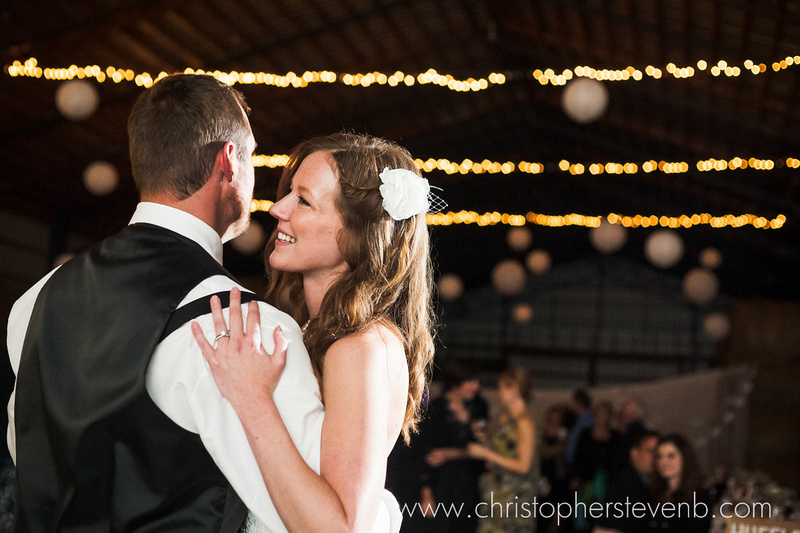 first dance between bride and groom with string lights