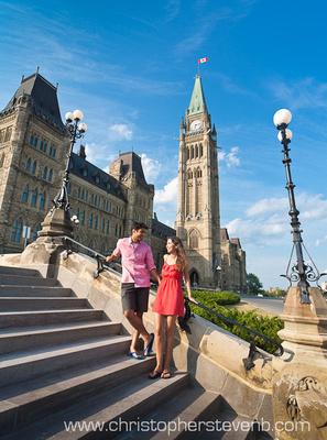 engagement photo of couple in front of parliament in Ottawa