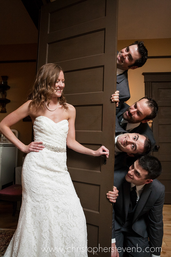 bride and brothers peeking funny bridal party photo