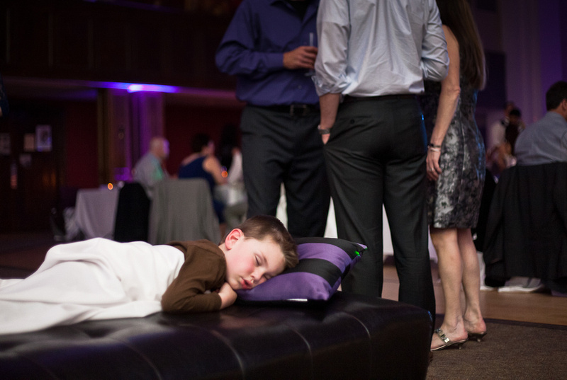 Child sleeping during wedding reception