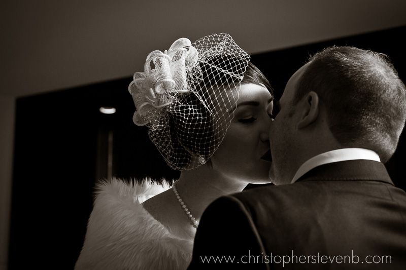 romantic classic wedding photo in sepia of bride and groom kissing
