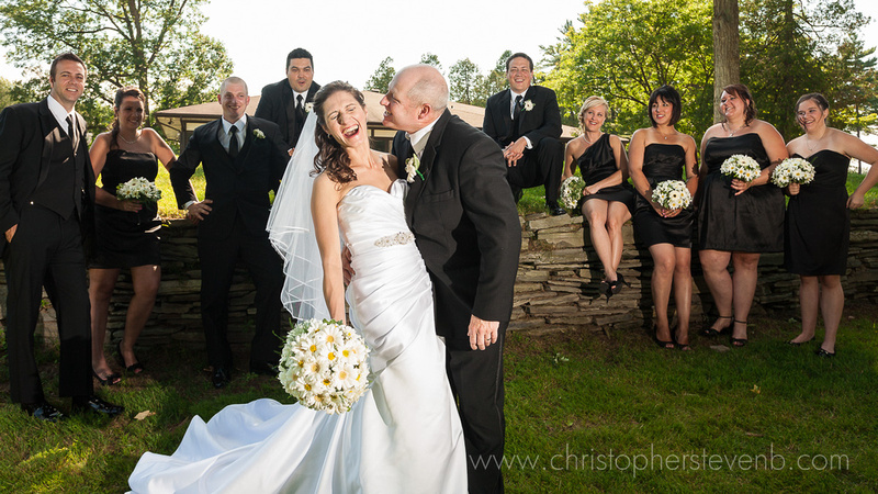 funny candid of the bride at outaouais golf club turning away from a kiss with bridal party laughing and smiling