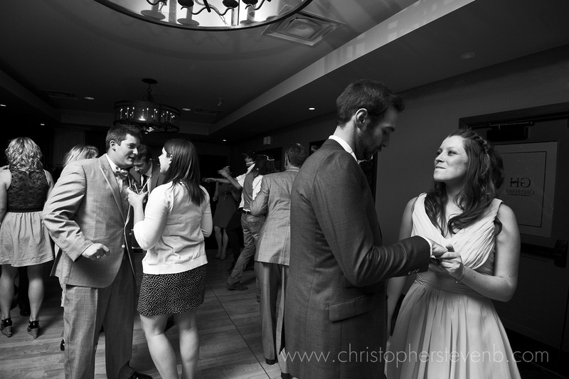 wedding guests dancing in black and white